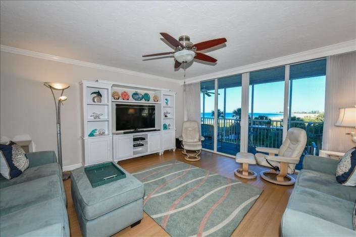 World-renowned Crescent Beach sunsets settle right outside the window of the 0306 condo rental.