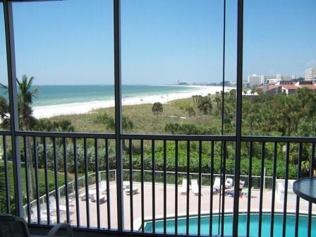 View of pool and the gulf from this vacation condo rental