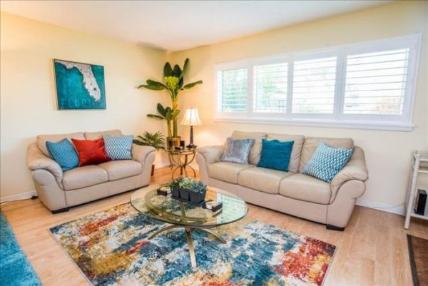 Well decorated living area in Villa 13 in crystal sands siesta key