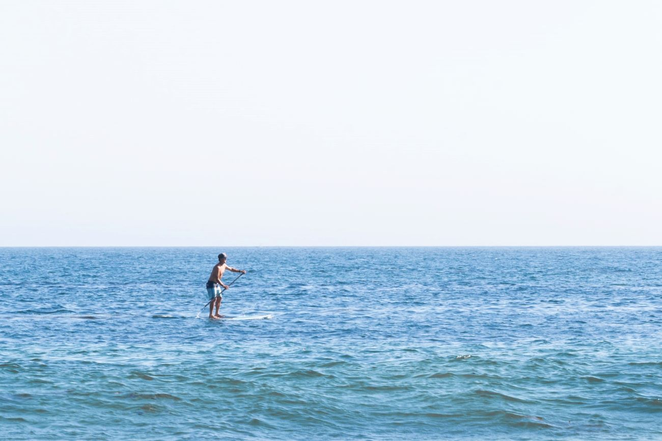 person on paddleboard in ocean
