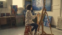 woman painting in art studio