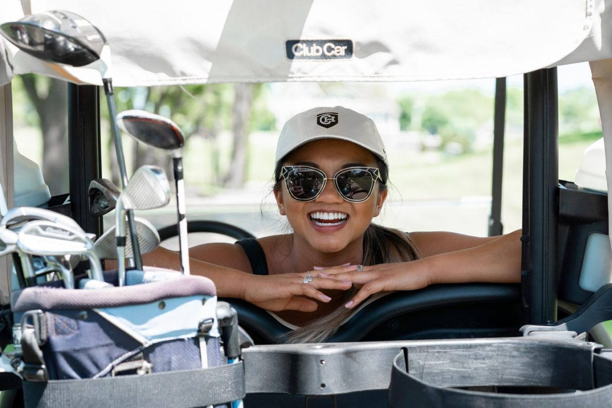 woman in a golf cart on the course