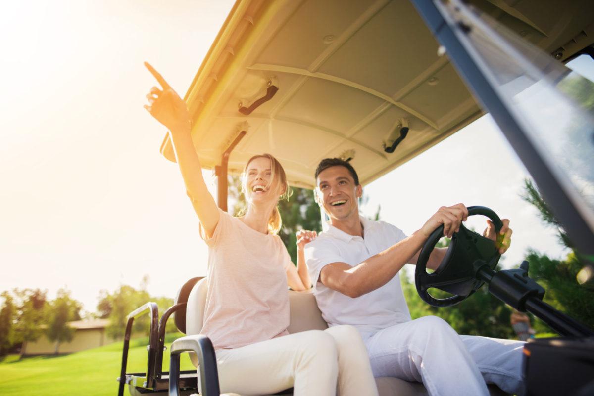Couple in golf cart navigating Siesta Key