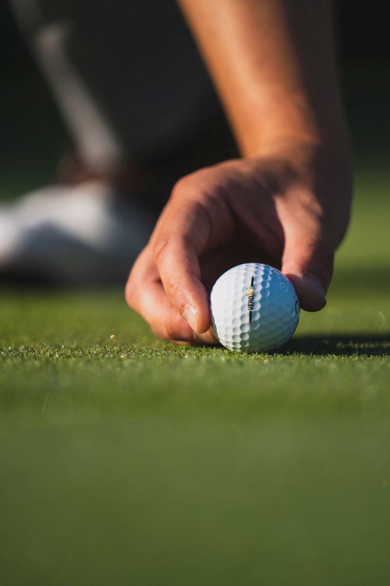 golf ball in hand