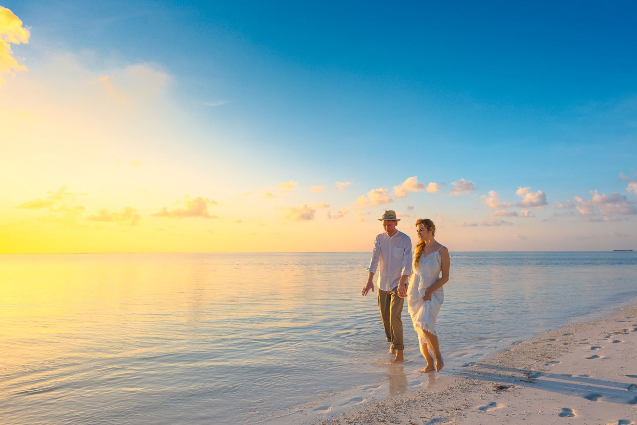 couple walking on siesta key beach